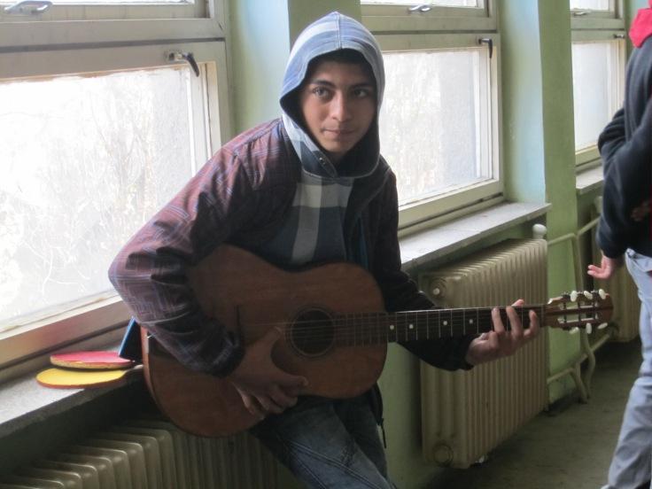 2013-10-24-boy playing guitar kezmarok