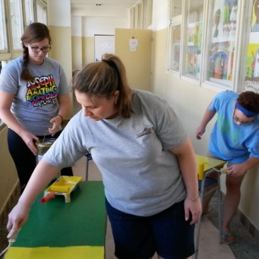 Painting desks (Roma School in Kosice).