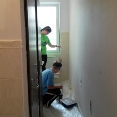 Painting bathrooms (Roma School in Kezmarok).
