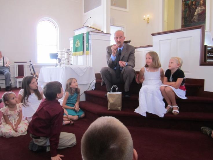 Jon shares the children's message during worship.