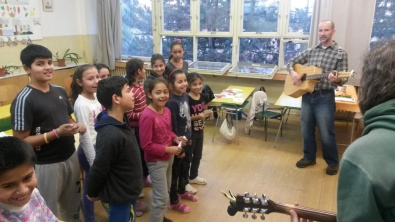 Working with some of the older children at the Roma school on a musical performance of a Christmas song (in English)