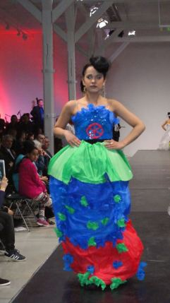One of the new dresses, created from recycled materials, that incorporates the Roma flag.